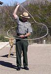 A Park Ranger doing rope tricks